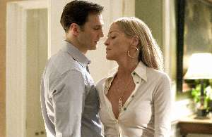 David Morrissey notices Sharon has some plastic caught in her shirt.  Oh no, hang on, that's her tit.