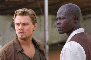 Leonardo DiCaprio and Djimon Hounsou are momentarily distracted by a three-headed monkey.