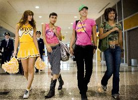 L-R: Mary Elizabeth Winstead, Rosario Dawson, Zoe Bell and Tracie Thoms wonder if the cheerleader outfit undermines the Girl Power movement a little.