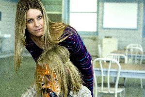 Sheri Moon Zombie didn't realise the camera was rolling when she pushed little Daeg Faerch's face into his spaghetti.