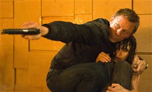 Daniel Craig protects Olga Kurylenko from the nasty men who want to steal their cheese wall.
