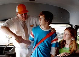 Kevin Heffernan as Ron Wilson the Bus Driver, with Michael Angarano.