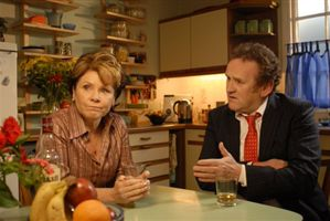Colm Meaney tries to explain to Imelda Staunton that you can't phone home from a starship.