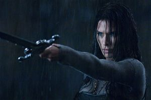 Rhona Mitra wished the police hadn't yelled 'Freeze!' at that particular moment, that sword's bloody heavy.